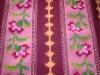 cuvertura tesuta in razboi orizontal cu motive florale
